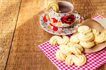 Homemade cookies with cup of hot chocolate on wooden table