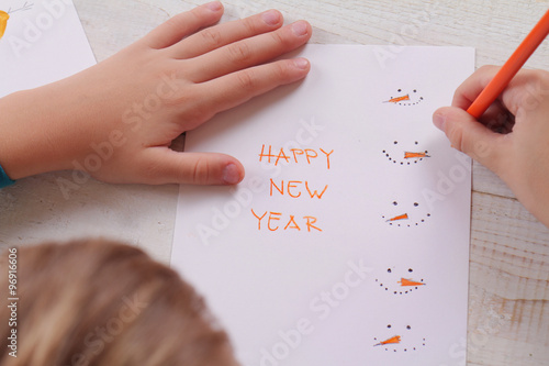 close up on childs hands making new year greeting card kids art handmade art