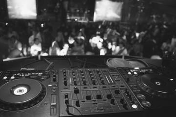 Black white dj mixer in party
