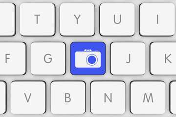Blue Photo Icon Button on White Computer Keyboard
