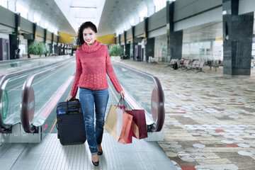 Indian tourist walking in the airport hall
