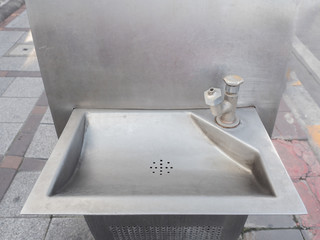 old faucet with sink in public park for drink.