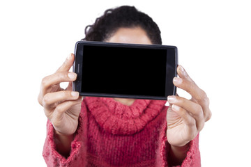 Woman holding cellphone with blank screen