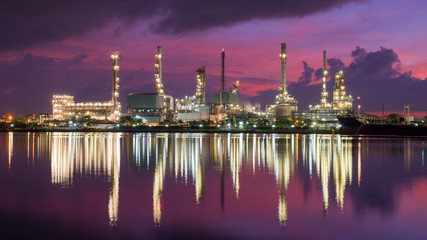 Oil tank ship mooring in oil refinery industry at twilight time