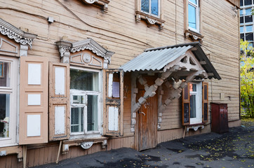 Two-storey wooden house with porch and window shutters on Irkutsk street