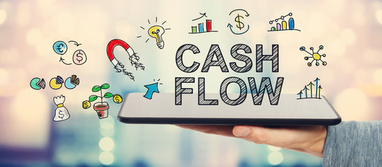 Cash Flow concept with man holding a tablet