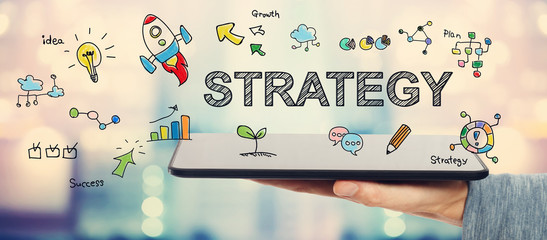 Strategy concept with man holding a tablet