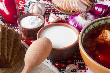 Sour cream in pottery for the borscht