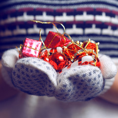 Woman holding a Christmas Decorations