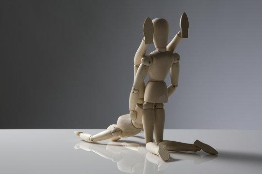 wooden figures having fun