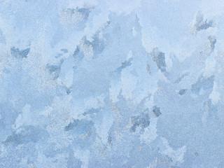 Frosty natural pattern on winter window.