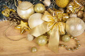 Christmas gold bow on wooden surface
