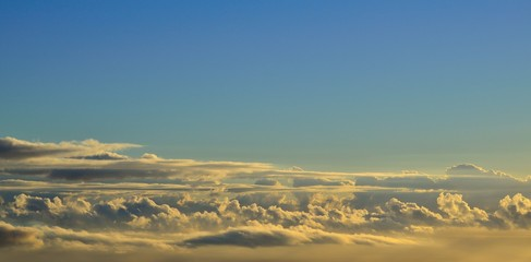 Autumn clouds with blue sky background