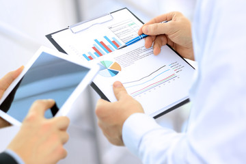 Business colleagues working and analyzing financial figures on a