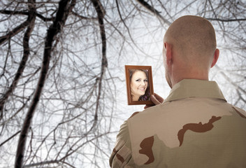 Soldier looks at the picture