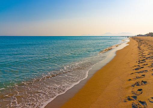 the beautiful long sandy beach at Chelona cape near Kardamaina village at Kos island in Greece