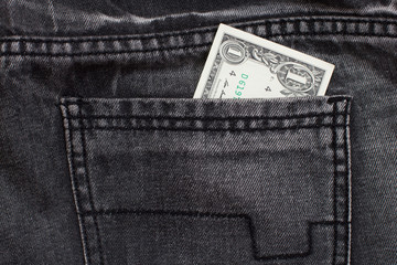 one dollar cash in jeans pocket