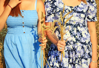 Girls Outdoors.Models girls on the Field. happy farmer enjoying great harvest, agricultural industry,