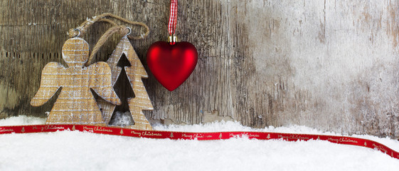 Christmas postcard with wooden background and snow