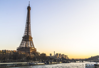 Eiffel Tower view from river at sunset