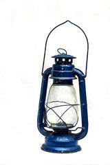 An antique petrol lamp