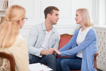 Attractive loving couple is visiting professional therapist