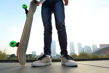 skateboarder with skateboard at  city