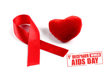 Aids ribbon and condom on white background.
