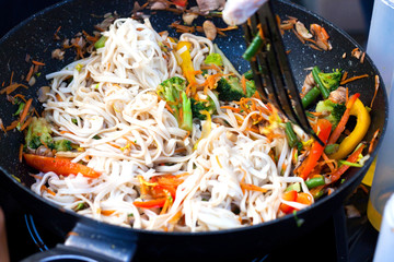 stir fried vegetables in the pan and pasta