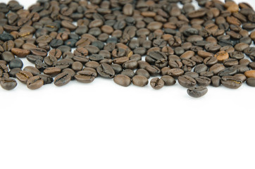 brown coffee beans on isolated background.