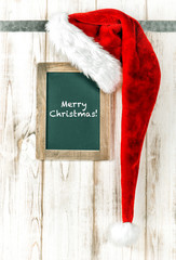 Red hat and vintage chalkboard. Merry Christmas retro style