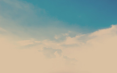 Cloudy blue sky abstract background. Vintage filter.