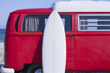 surf board and van