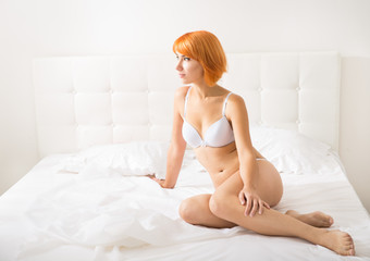 Red-haired woman in lingerie