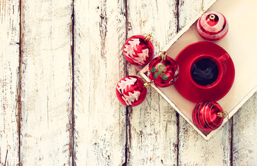 top view image of coffe cup and christmas tree decorations