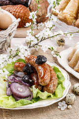 Sausage with plums and onion