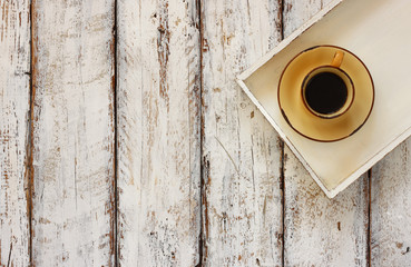 top view image of cup of tea on a white wooden tray old table.