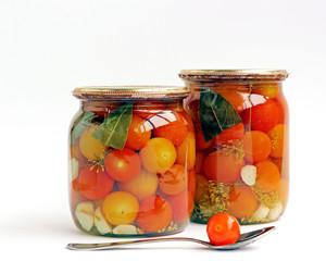 Tinned cherry tomatoes in glass jars