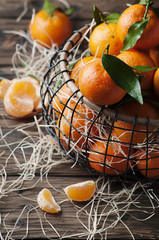 Sweet fresh tangerins on the vintage table