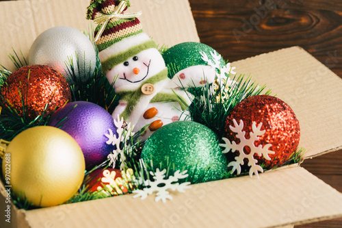 christmas decorations and toys in a cardboard box on a wooden ba - Cardboard Box Christmas Decorations