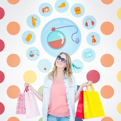 Composite image of woman holding some shopping bags