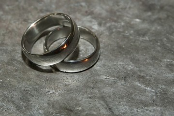 Photo forged wedding rings. Picture of wedding rings on the anvil. Reflection forge fire.