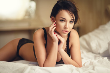 Beautiful girl in a sexy lingerie on the bed