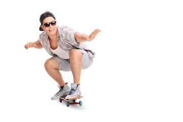 Young joyful skater riding a skateboard