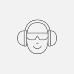Man in headphones line icon.
