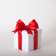 Gift box with ribbon and bow. Present.