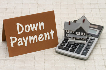 Home Mortgage Down Payment, A gray house, brown card and calcula