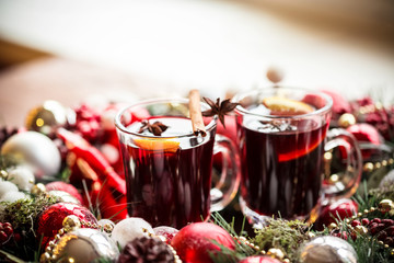 Christmas hot mulled wine with spices on a wooden table. The idea for creating greeting cards