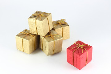 Gift box wrap gold and red paper with gold ribbon and isolated background