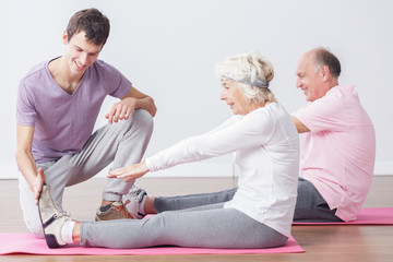 Sporty seniors at fitness studio